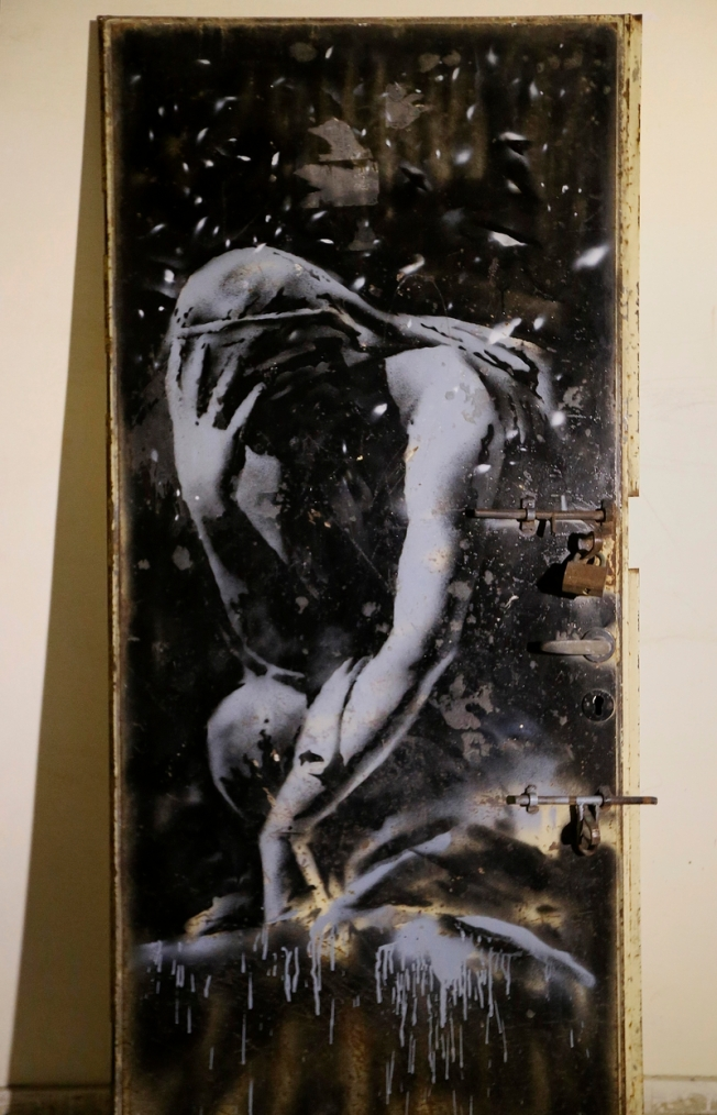 A Greek Goddess Niobé ~ Banksy  (AP Photo/Adel Hana)